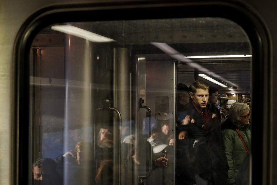 Commuters crowded into the compartments between trains on the Haverhill line out of Boston.